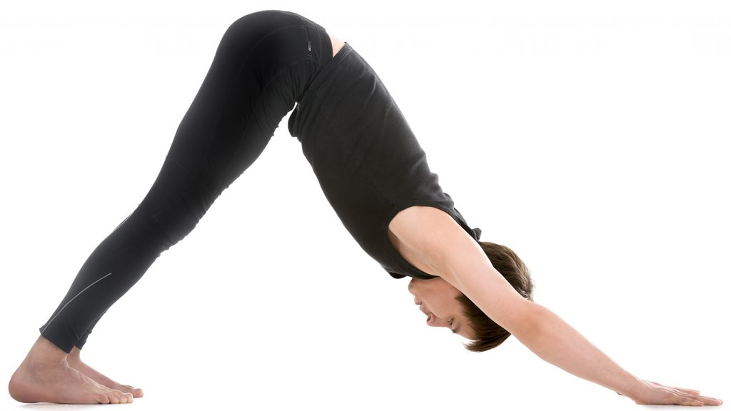 young man dressed in all black stretching his body downward into a v shape